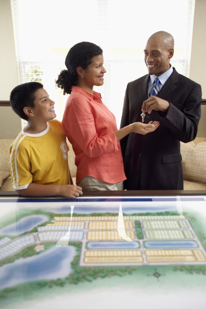 Salesman Handing House Keys to Woman
